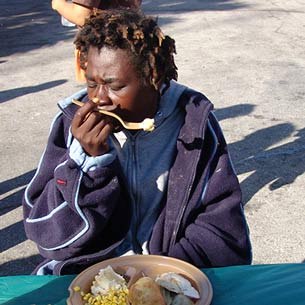 Helping those is the greatest of need. Woman eating.